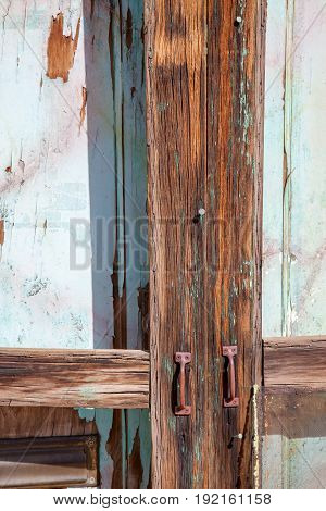 Weathered Old Abandoned Painted Door Rusty Handles
