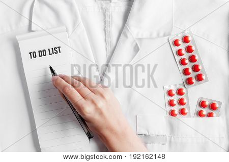 doctor's work place with stethoscope and copybook on hospital overall background top view mock up
