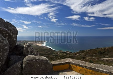 Panoramic view from the Sintra Mountain range towards the Guincho Beach near Lisbon Portugal