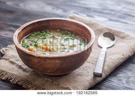 Bowl of italian chicken pasta soup with parmesan