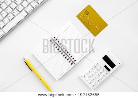 accountant or banker desk with calculator, keyboard and notebook on white background top view mockup