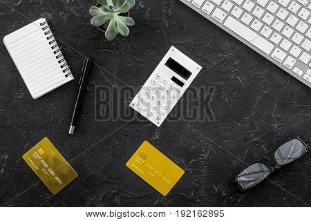 online purchasing with credit cards and notebook on dark manager desk background top view mock-up
