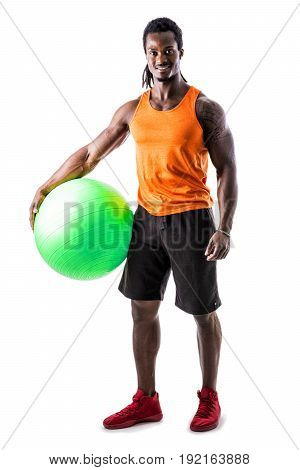 Muscular man holding inflatable fitness ball, looking at camera, standing isolated on white background