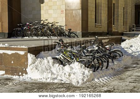 MOSCOW RUSSIA JANIARY 11 2017: Big group of bicycles left for the winter near the entrance to the main building of Moscow State University.