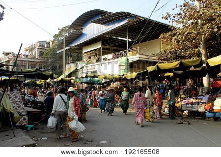 ZEGYO MARKET/MANDALAY, MYANMAR JAN 22: Street at the Zegyo Market with stalls selling mostly garnements, bags and other non-food products January 22, 2016, Zegyo Market, Mandalay.
