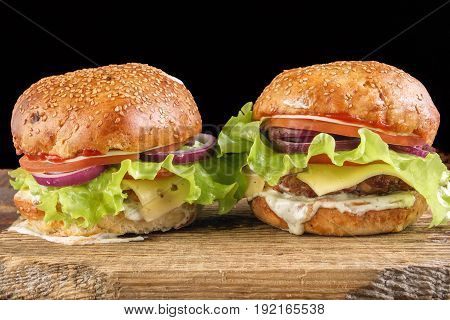 Homemade Burgers On Wooden. Close-up