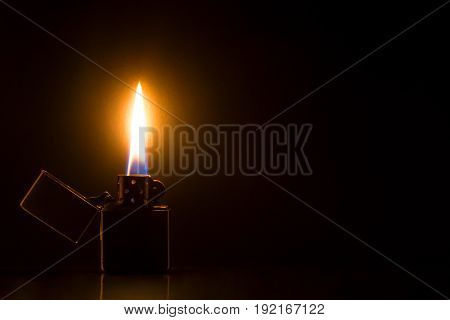 Zippo Lighter on black background macro fier