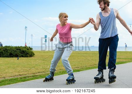 Roller Skater Couple Skating Outdoor