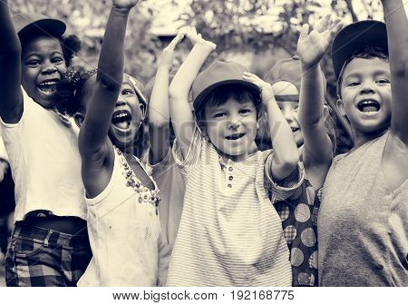 Group of kids school friends hand raised happiness smiling learning