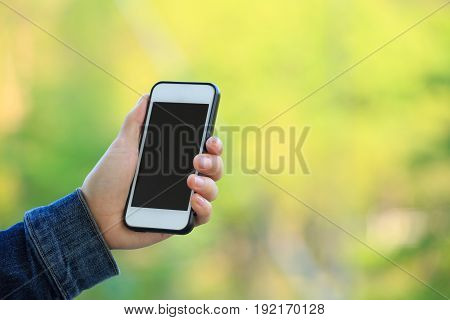 closeup of hand use smartphone at city