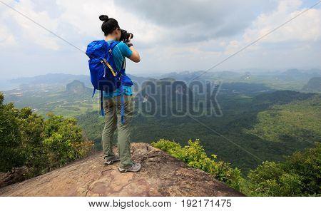 successful woman hiker enjoy the view hiking on mountain peak