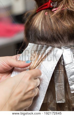 weave hair in a beauty salon , hair color. A photo