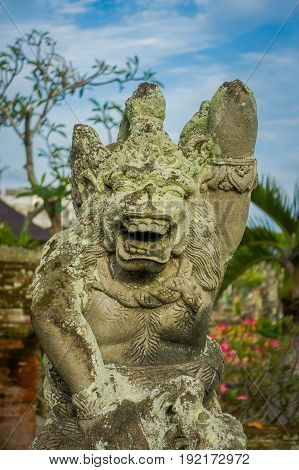 BALI, INDONESIA - MARCH 08, 2017: Stone statute in Semarapura, Kertha Gosa Pavilion in Klungkung Palace, in a beautiful day in Denpasar Indonesia.