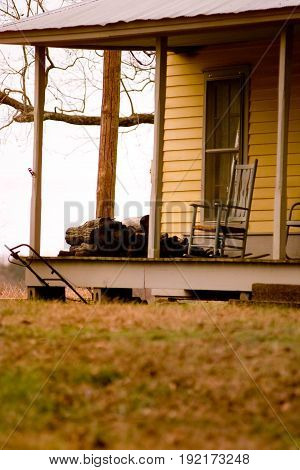Rocking Chair Sitting on Porch of Old Home in Arkansas