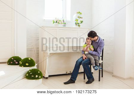 family, childhood, fatherhood, activity and people concept - happy father and little son playing at home.