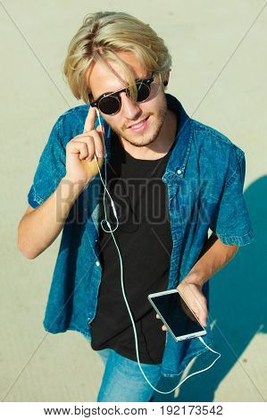 Blonde Man In Sunglasses Listening To Music
