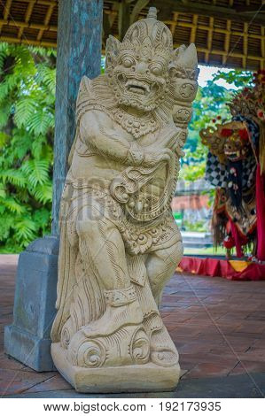 BALI, INDONESIA - MARCH 08, 2017: Beautiful stone statue inside of the Royal temple of Mengwi Empire located in Mengwi in Bali, Indonesia.