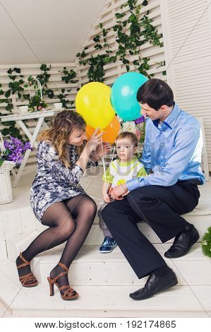 kid with parents celebrating birthday. Happy family celebrating birth day together