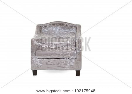 Gray cloth armchair placed on a white background cover with plastic inserts.