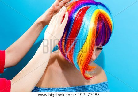 Woman in a bright wig with her fashion stylist