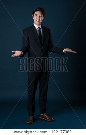 East Asian Businessman shooting studio portrait shot
