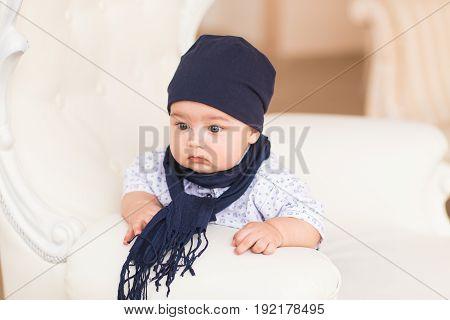 Portrait of cute baby boy wearing blue hat