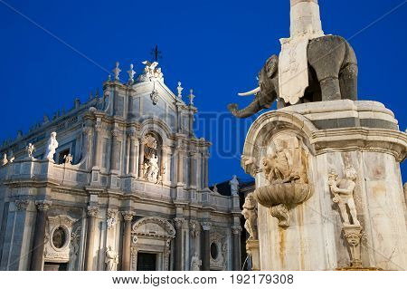 The famous lava stone elephant in the main square of Catania Sicily with a view of St. Agatha church