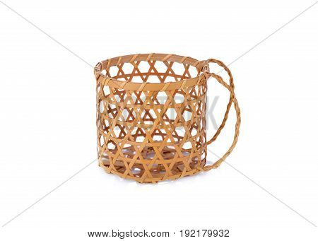 empty bamboo basket with hilt on white background