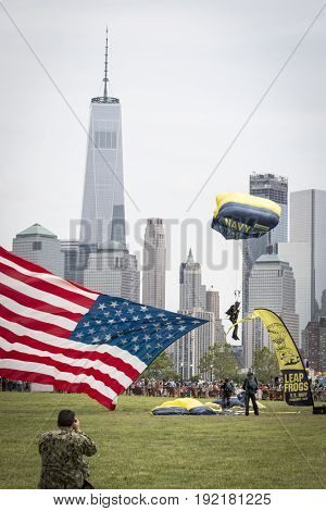A member of The Leap Frogs, the elite U.S. Navy Parachute Team, tows an American Flag during a demonstration at Fleet Week 2017 in Liberty State Park, JERSEY CITY NJ MAY 28 2017