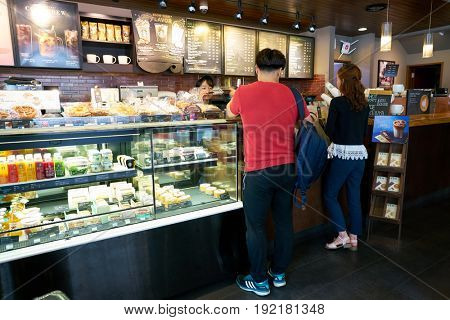 SEOUL, SOUTH KOREA - CIRCA MAY, 2017: display case at Starbucks in Seoul. Starbucks Corporation is an American coffee company and coffeehouse chain.