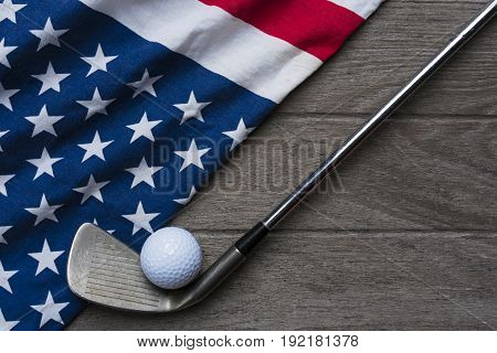 Golf ball with flag of USA on wood table