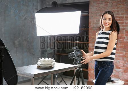 Beautiful young woman during photography classes