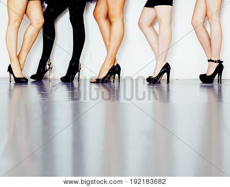 diverse type pair of woman legs in high heel black shoes isolated on white background and floor, diversity people lifestyle concept close up