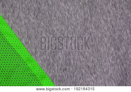 Top view of cloth textile surface. Close-up rumpled heater and knitted fabric texture with a thin striped pattern. Sport clothing fabric texture. Colored basketball shirt and heater hoodie