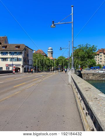 Zurich, Switzerland - 18 June, 2017: view along Rudolf Brun bridge over the Limmat river, the tower of the Urania observatory in the background. Zurich is the largest city in Switzerland and the capital of the Swiss canton of Zurich.