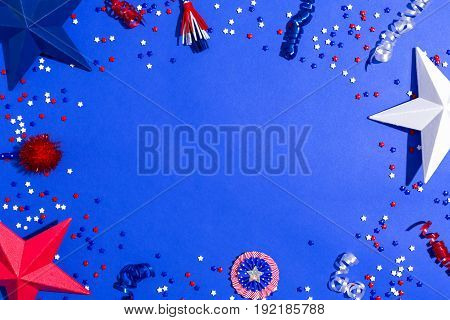 USA holiday decorations on a blue background flat lay