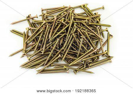 A Multitude Galvanized Golden Screws On White Background