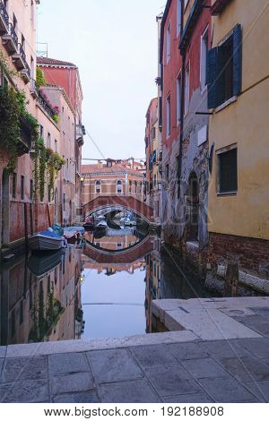 landscape with the image of a channel at sunrise in Venice, Italy