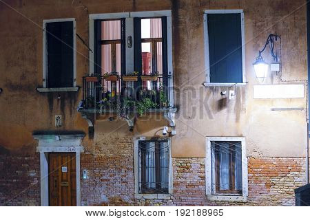 facade of an inhabitable house at night in Venice, Italy