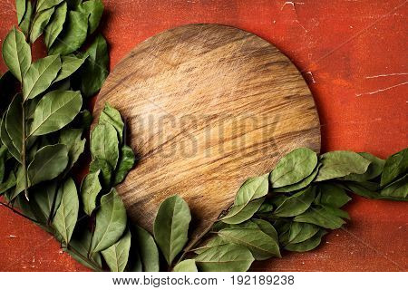 Round Wooden Cutting Board On Red