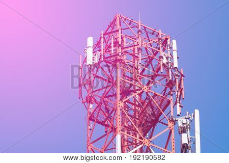 Mobile Phone Communication Antenna Tower With Satellite Dish On Blue Sky Background, Soft Tone.
