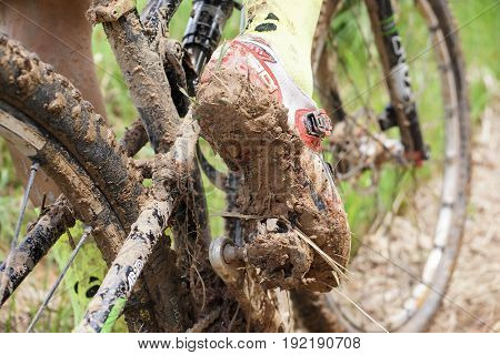 Dirty mountain bike covered with mud and dirt / Cycling in muddy and wet condition concept
