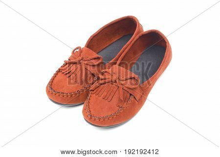 A pair of brown moccasins isolated on white