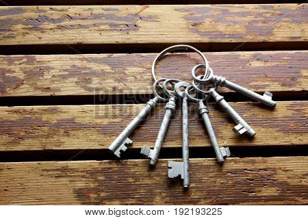 Bunch of Keys on a Wooden Background