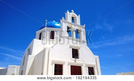 One of the famous blue and white buildings in Oia on Santorini island in Greece