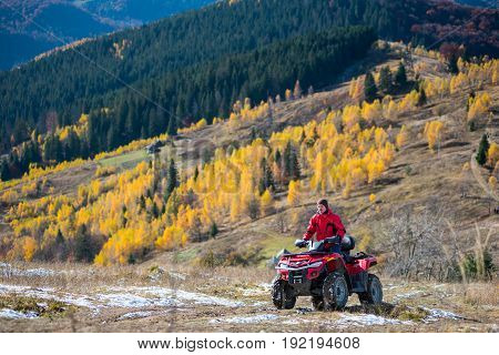 Guy Is Driving Red Quad Bike On A Mountain Road Passes To The Top Of The Mountain Followed By A Beau