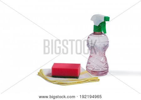 Spray bottle and cleaning equipment on white background