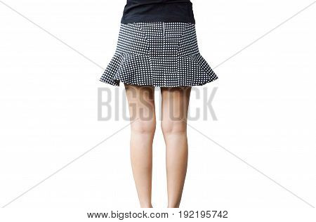 A female wearing a short mini skirt