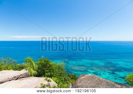 travel, seascape and nature concept - view to indian ocean from seychelles island
