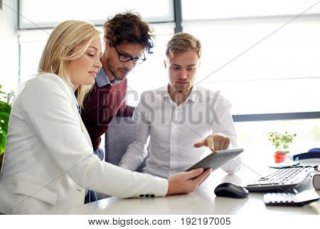 business, technology, break and people concept - happy creative team with tablet pc computer at office